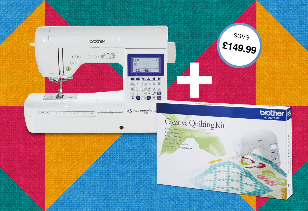 Brother Innov-is F420 sewing machine and quilt kit on quilt background