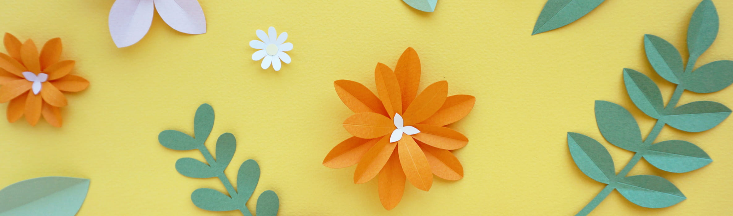 paper cut out plants on a yellow background