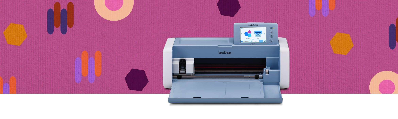 Scanncut SDX1200 на розовом фоне бумаги