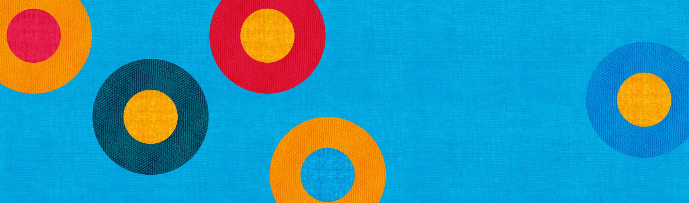 Veelkleurige cirkels op een blauwe achtergrond