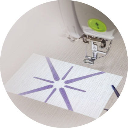 embroidery pattern projected on material