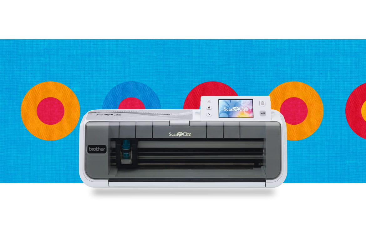 CM300 scancut machine on a blue background with coloured circles