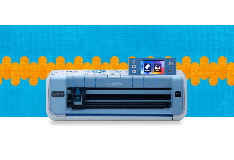 CM800Q scanncut machine on a blue and orange background