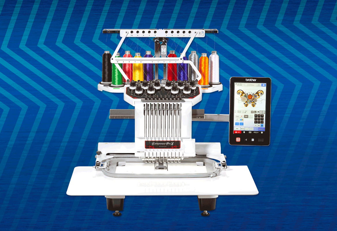 Brother PR1050X embroidery machine on blue zigzag background