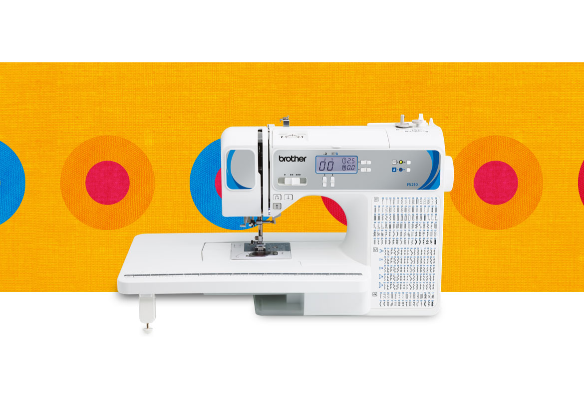 FS210 sewing machine on a multicoloured background