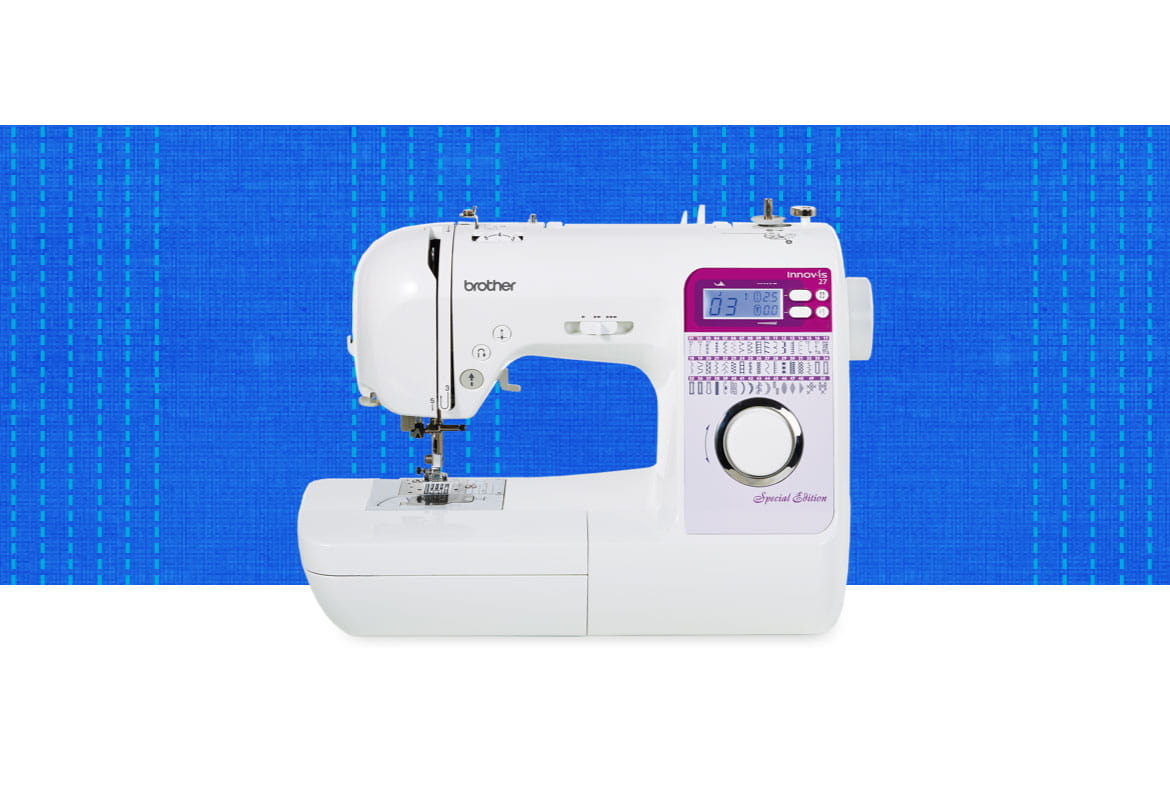 Innov-is 27SE sewing machine on a blue pattern background