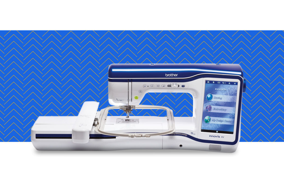 Innov-is-XV sewing and embroidery machine on a blue pattern background