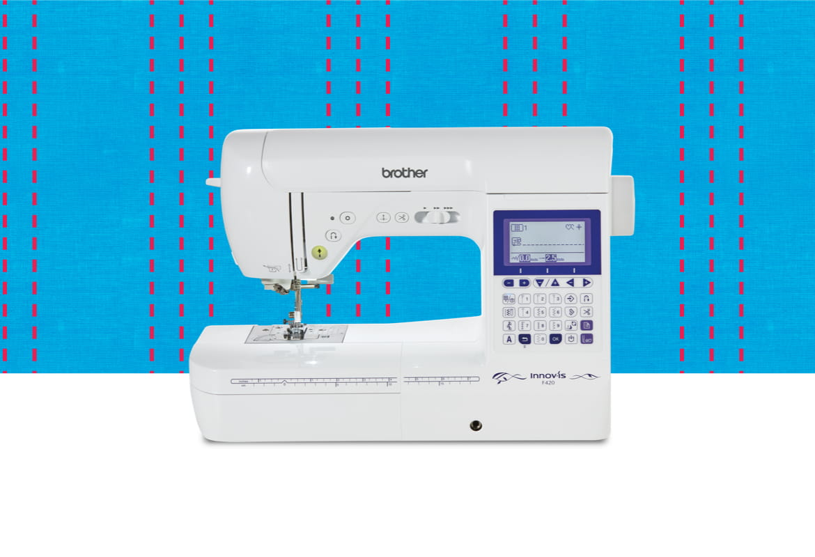 F420 sewing machine on a light blue pattern background