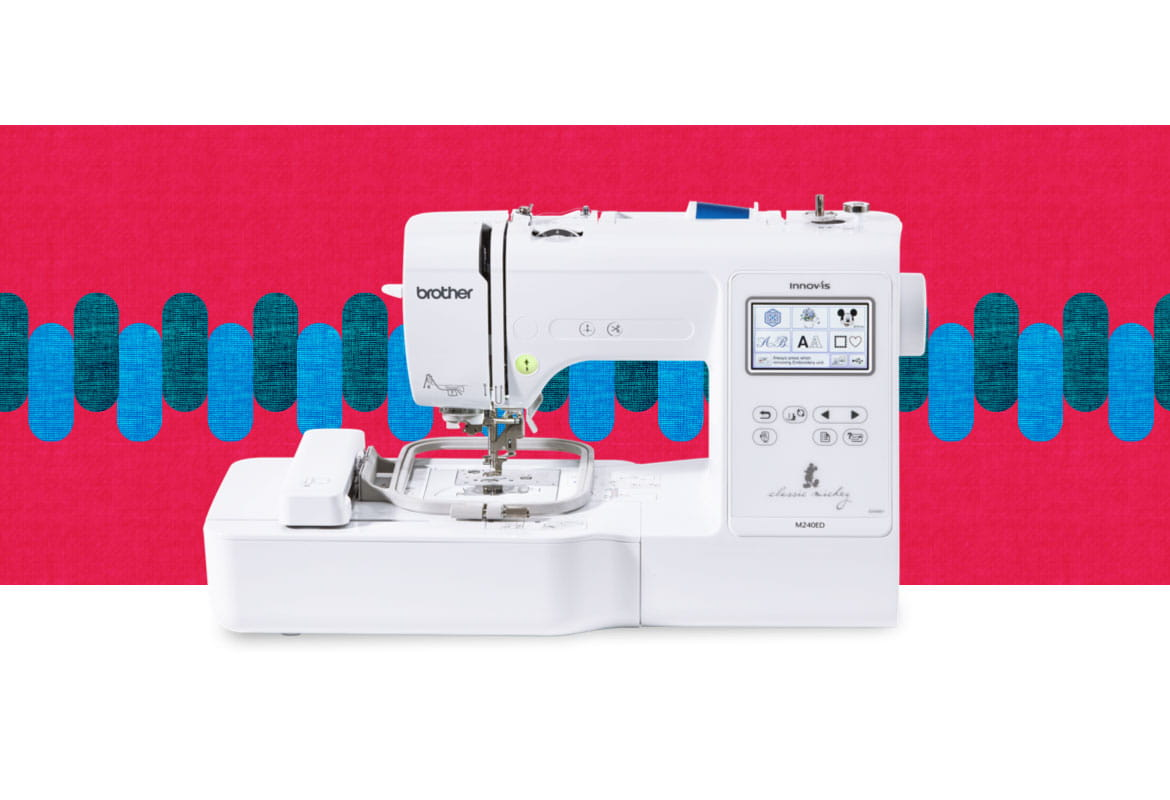 M240ED embroidery machine on a multicoloured background