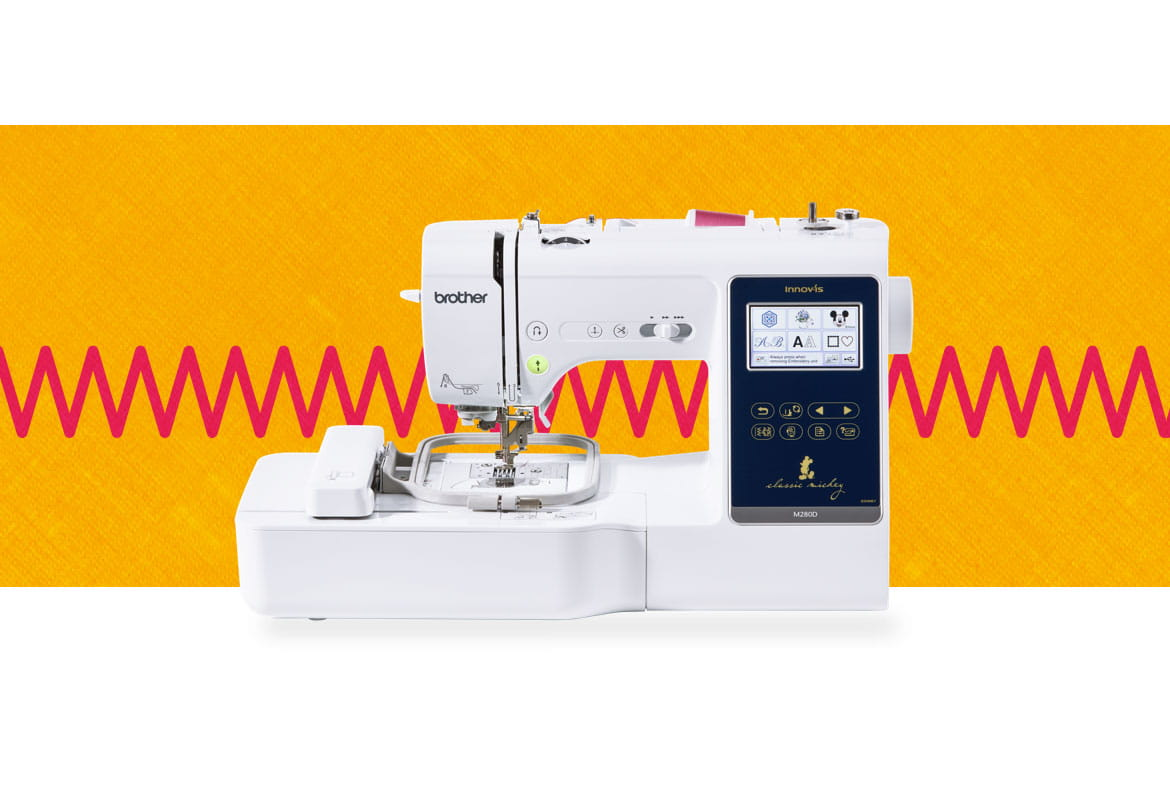 M280D sewing and embroidery machine on an orange and red background