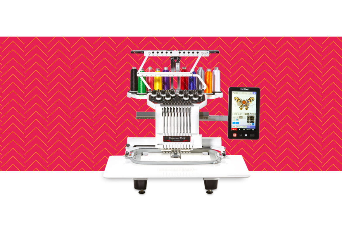 PR1050X embroidery machine on a red pattern background