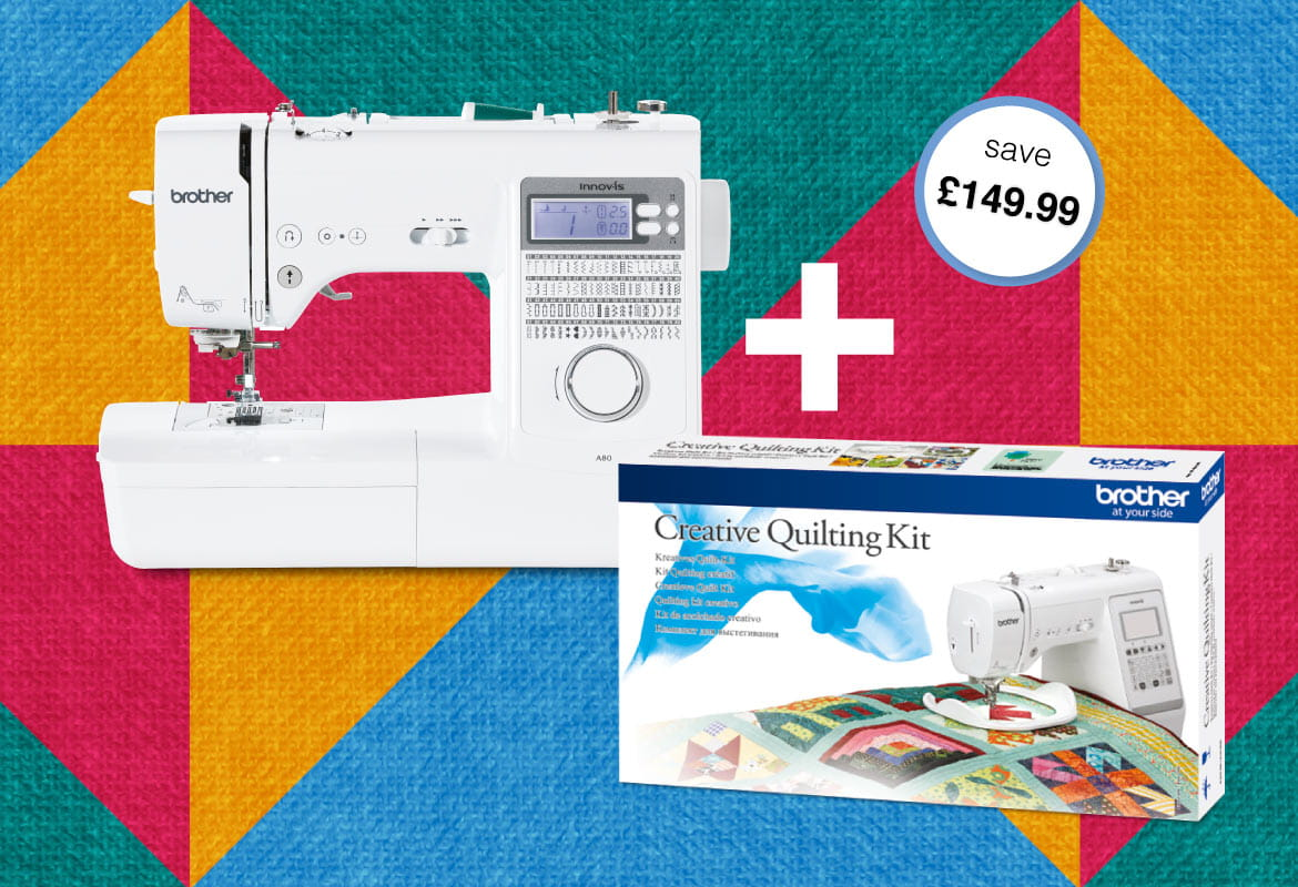Brother Innov-is 80 sewing machine and quilt kit on quilt background