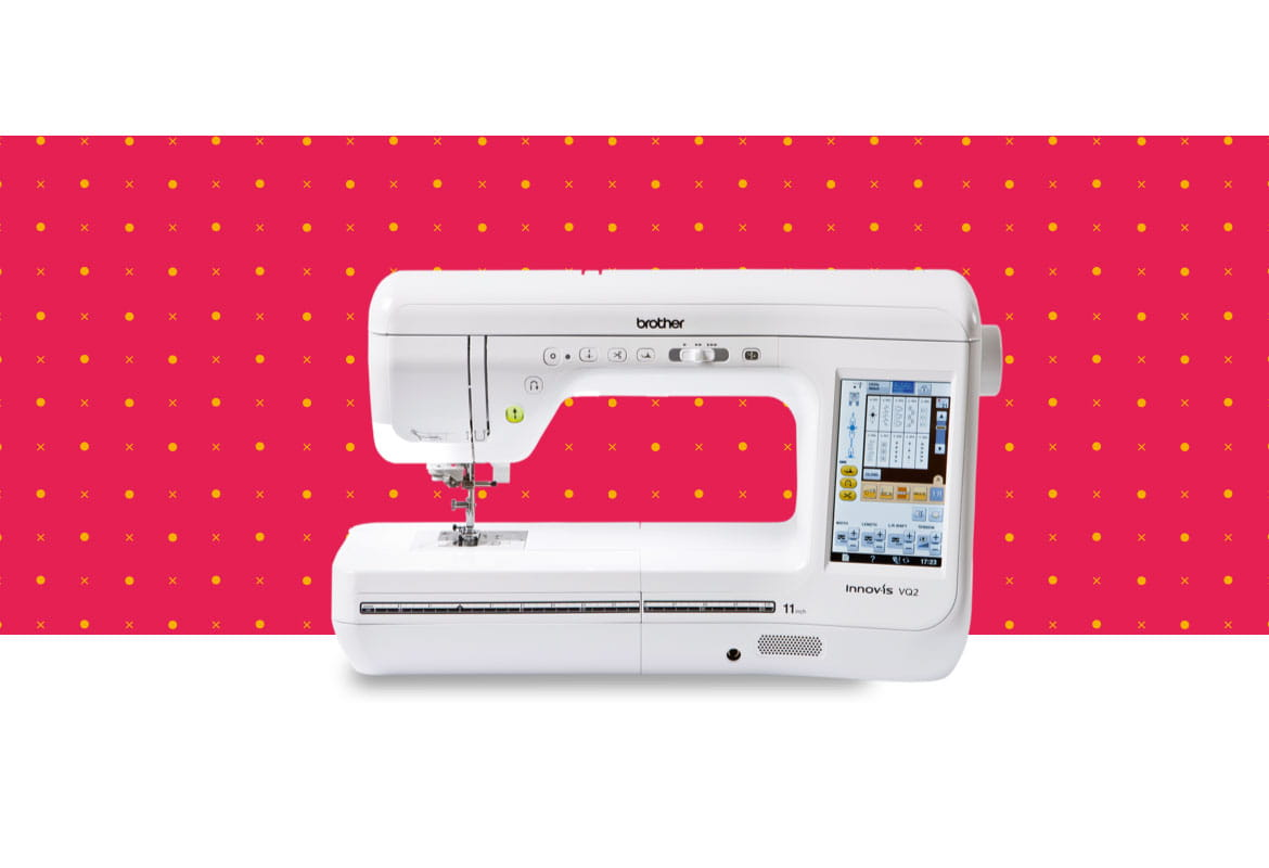 VQ2 sewing machine on a red pattern background