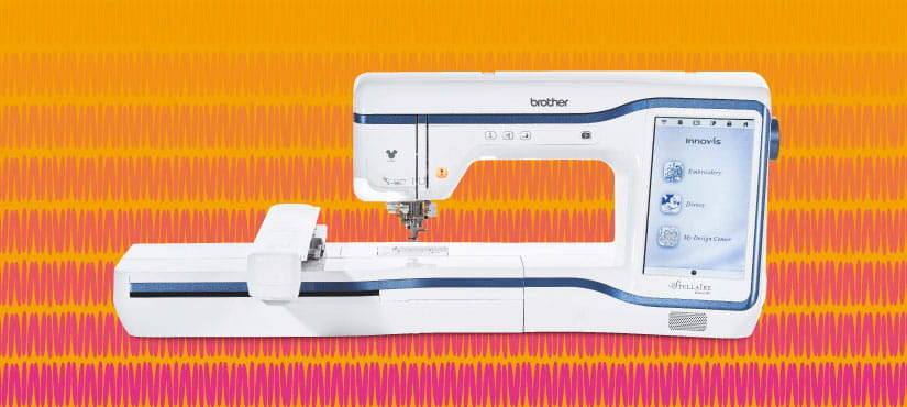 Embroidery machine on blue pattern background